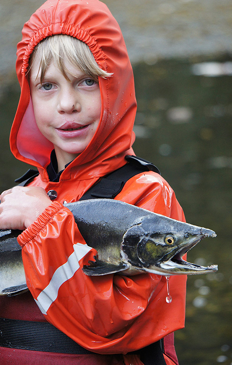 Child with Salmon on an Alaska Family Vacation Cruise
